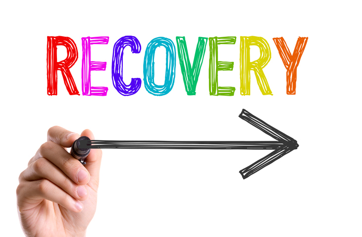 "Image of a hand holding an arrow below word ""RECOVERY""."