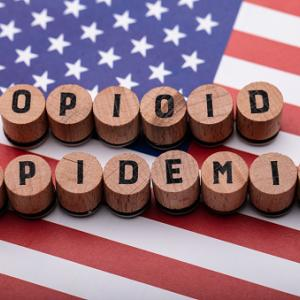 US Flag and blocks spelling Opioid Epidemic