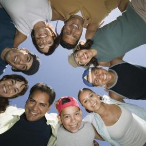 Image of youth in a circle from below.