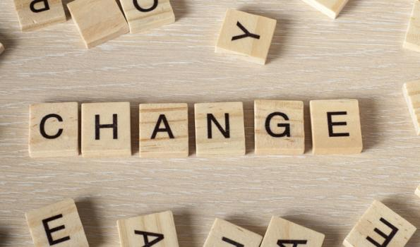 Change spelled out in tan scrabble letters