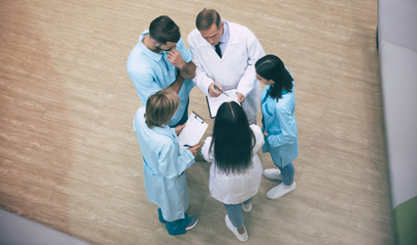Image of clinicians standing in a circle